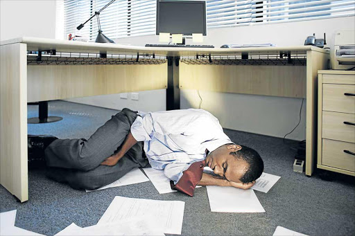 CATCH UP: While under your desk might not be the best place to take a nap, a 20-minute daytime nap is said to be the equivalent of an hour at night Picture: ISTOCK.COM
