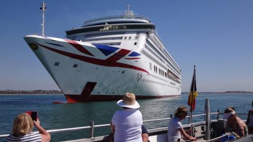 Mudeford Ferry passengers get a close look at P&O's Britannia.