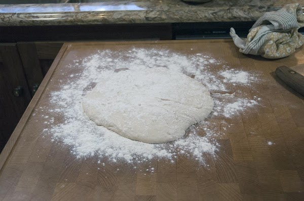 Remove from the bowl, and place on a lightly floured surface.