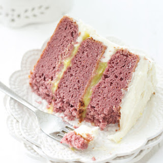 Raspberry Cake with Lemon Curd Filling and White Chocolate Icing.