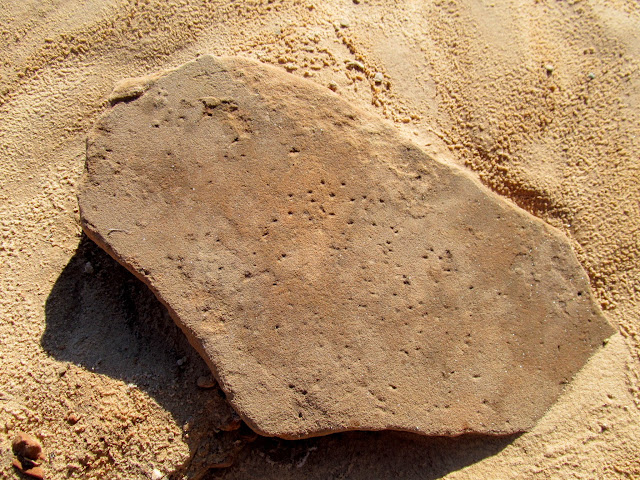 Pecked grinding stone