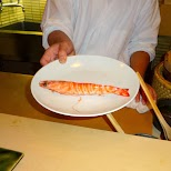 preparing a fresh giant shrimp for my lunch in Roppongi, Tokyo, Japan