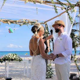 Sailing on By by Lena Arkell - Wedding Ceremony ( bride, blue sky, groom, mexico, caribbean, parachute, bride and groom, beach, wedding, parasailing, palm trees,  )