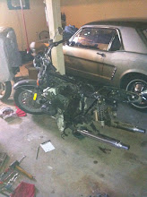 Photo: Supposedly you don't have to remove the rear wheel to remove the transmission. But the custom saddlebags interfered with the driveshaft pulling far enough away, so I removed everything.