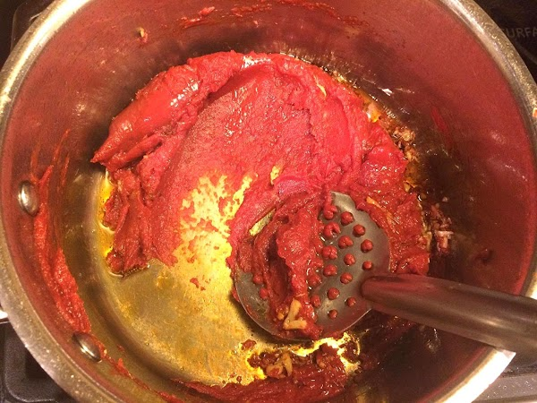 Now stir in 2-6 oz cans of tomato paste (no herbs added/with salt) into...