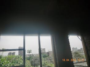 Photo: First Floor, LHS Bedroom, backside window and door details