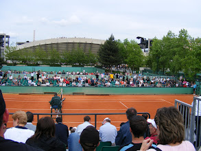 Photo: Later that day, we take advantage of special evening tickets to Roland Garros, admitting us to outer court matches at the French Open for only 10 euros.
