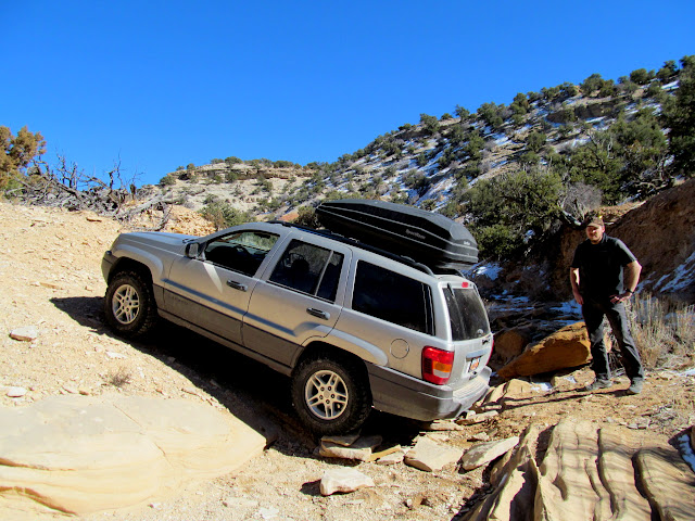 Stacking rocks to get unstuck on the Sagebrush Bench road