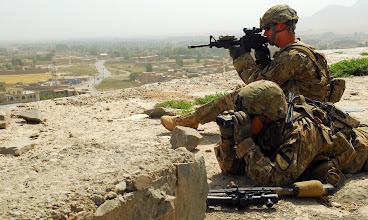 Photo: U.S. Army Staff Sgt. Derrik Browne of Columbus, Ind., and U.S. Army Sgt. Jason Andrade of Bastrob, Texas, both squad leaders in Operations Company, Headquarters and Headquarters Battalion, 1st Cavalry Division, provide security June 27 during a visit by Army officials to Bala Hesar, a fortress in Gardez that is home to a new Afghan quick reaction force. The force is comprised of Afghan National Army, Afghan Uniformed Police, Afghan Border Police, and Afghan National Civil Order Police members. (Photo by U.S. Army Spc. Adam L. Mathis, 17th Public Affairs Detachment)