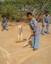 Photo: Playing cricket with new equipment