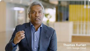 CEO of Google Cloud, Thomas Kurian, facing camera in a blue suit