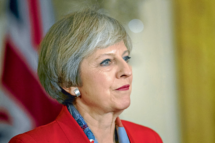 Theresa May: Holding companies to account. Picture: BLOOMBERG/ANDREW HARRER