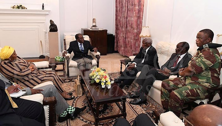 President Robert Mugabe (C) in a meeting with the ZDF Commander General Constantino Chiwenga,  South African Minister of Defence Minister Nosiviwe Mapisa-Nqakula (in yellow head gear), Zimbabwe Defence Minister Dr Sydney Sekeramayi and Zimbabwe State Security Minister Cde Kembo Mohadi  at State House in Harare, Zimbabwe November 16, 2017.