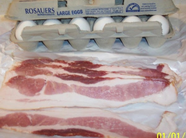 Fry the bacon.Put everything into a large pot, and cover with warm water.Bring to...