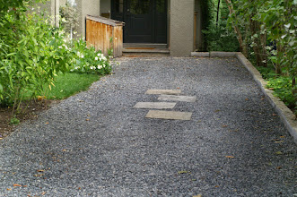 Photo: Our society is too stuck on asphalt. This black granite gravel is beautiful and lets rain soak in and be cleaned and cooled by nature.
