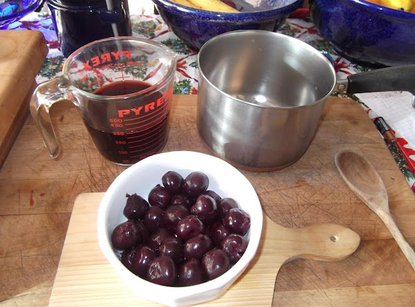 For DARK CHERRY SAUCE:Drain syrup from cherries into a 2-cup measure; add water to...