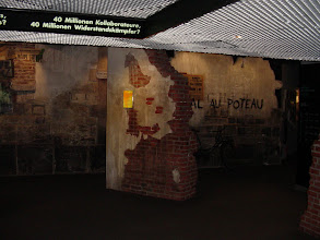 Photo: Most of the museum is devoted to events leading up to WW II, and its resolution. Here, the reconstruction of a town wall from the French Resistance period.