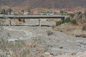 Photo: Shelters (houses?) in the riverbed