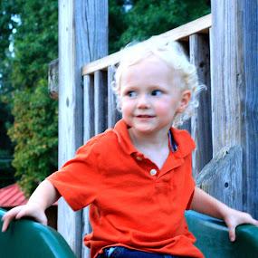 Boy on a slide. by Jay Rives - Babies & Children Children Candids ( sunset, blond, candid, slide, boy )
