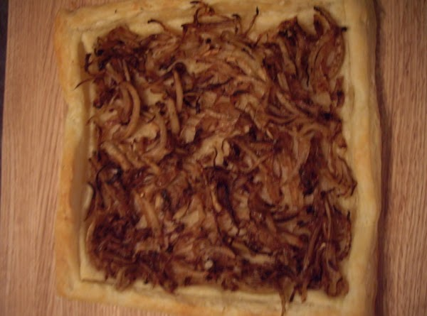 Unfold puff pastry onto an ungreased baking sheet. Using a knife score a 1...