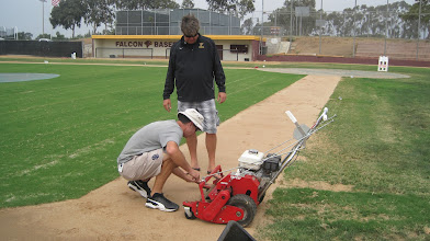 Photo: Checking the mower for good quaility of cut.