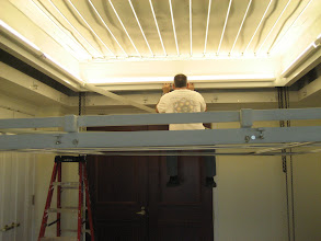 Photo: Jerry, the foreman from my remodel, hanging in the ceiling doing some last minute adjustments to the flourescent lighting before the install begins.