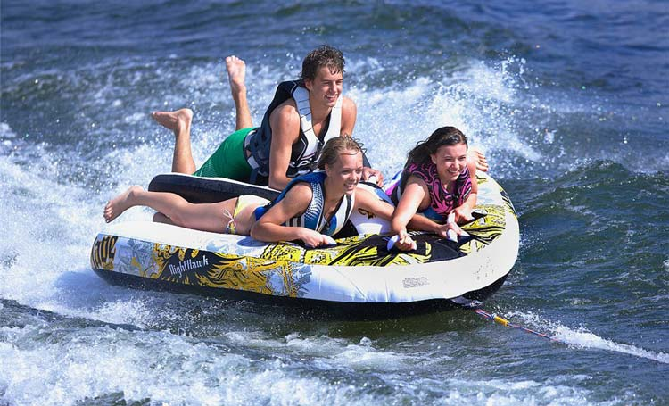Family water sports fun at YallaBanana. Think about whether you'd like to arrange your own water sports or land activities during your cruise to save some money.