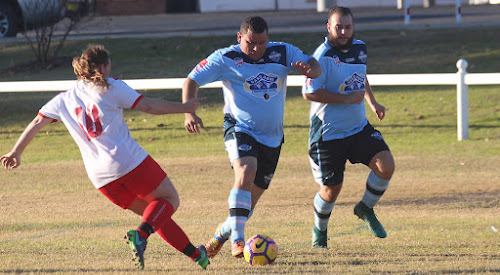 Narrabri FC left winger Mitch Wood beats a defender on Saturday at Hogan Oval in his side's 1-1 draw with Moree Services FC One. Overlapping in support is Narrabri FC left back Matt Dunn.