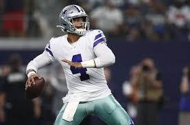 Dak Prescott throwing a pass