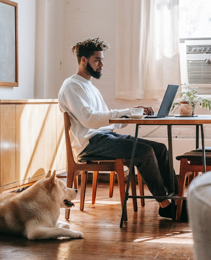 Man working o his laptop at home