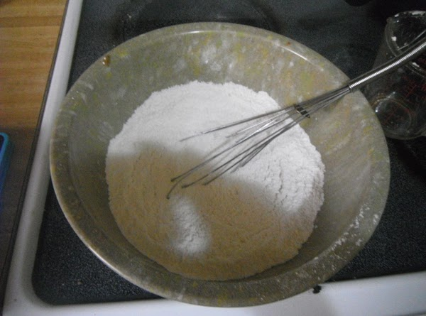 NOW IN A LARGE BOWL MIX FLOUR,BAKING POWDER,SALT TOGETHER WELL
