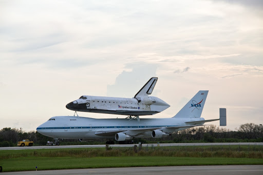 Atlantis atop a Shuttle Carrier Aircraft is towed from the runway at NASA's Kennedy Space Center in Florida.