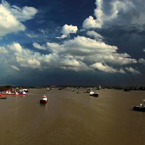 Mahakam River by Havidz Zhurrahman - Landscapes Cloud Formations ( east borneo, samarinda, dockyard, cloudy, mahakam river, landscape )