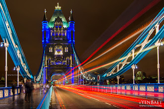 Photo: Light Trails on Tower Bridge - London, U.K.  Undeniably one that's been done a thousand times before, but I can't resist the different colored lights on the bridge this time. And who could also resist those omnipresent double deckers that are always a big help in successfully creating this scene. .. The Tower Bridge, a combined bascule suspension bridge with two distinct towers got its name from the nearby Tower of London. It really does not need further introduction as it is one of the most famous and recognizable icons of London.  #TowerBridge   #London2012   #UK   #Olympics   #England   #Travel   #Photography   © Yen Baet - www.YenBaet.com. All Rights Reserved. Join me on Facebook at www.facebook.com/YenBaetPhotography