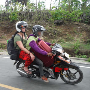 Mom on a scooty bike in Timor-Leste | Krys Kolumbus Travel Blog