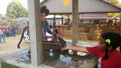 Photo: washing hands at the well