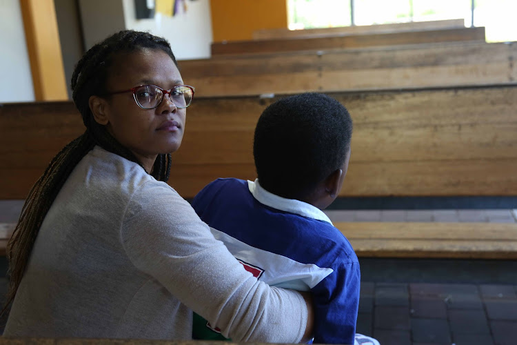 Lulumisa Ncwana with her 11-year-old special-needs son Lunzulu who she says was severely burnt at school. The school has denied any knowledge of the incident.