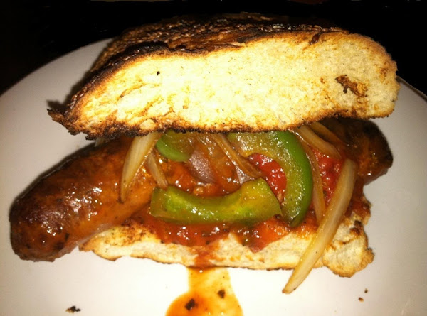 Grilled 12 Grain French Bread, Sundried Tomatos, Onions, Peppers And Italian Sausage Sandwhiches Recipe