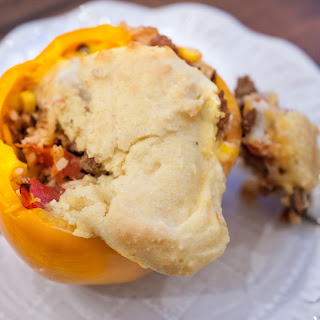 Gluten Free Stuffed Bell Peppers Topped with Cheese and Cornbread.