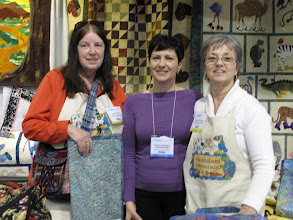 "Photo: Mary and Trisha with Carla Canonico, Editor-in-Chief of ""A Needle Pulling Thread"" magazine in their booth at the Creativ Festival in Toronto, April 15, 16, 2011"