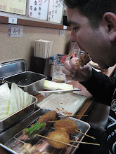 Photo: This place has yakitori, (skewered meats and veggies,) that are then battered and fried like tempura. There's a communal dipping thing in front of you that you dip for flavor.