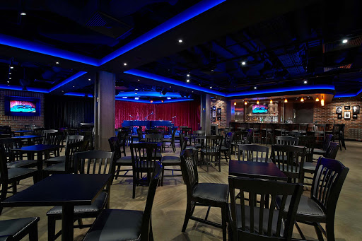 Norwegian-Escape-Headliners-lounge - Laugh it up at Headliners, one of 21 bars and lounges on board Norwegian Escape.