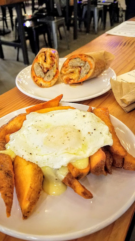 Brunch at Pine Street Market includes Pollo Bravo with their Potatoes Bravas with Sunny Side Egg