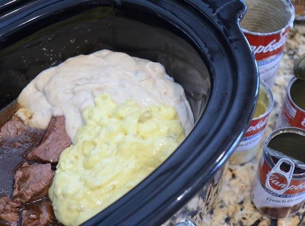 Dump the beef tips in the crock pot with the cans of soup. Stir.