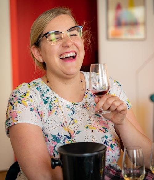 wine dine Caroline virtual wine tasting host tasting wine and laughing