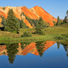 Euphoria by Becky Kempf - Landscapes Mountains & Hills ( orange, reflection, blue, rocky mountains, colorado, lake, rockies, pine trees )