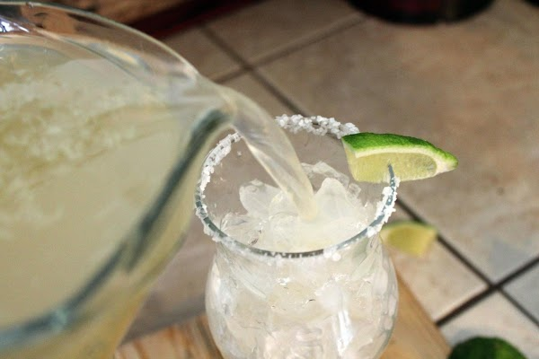 Add ice to glass, fill with margarita mixture and serve. (Garnish with slice of...