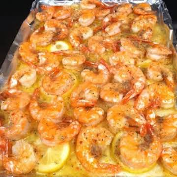 Melt a stick of butter in the pan. Slice one lemon and layer it on top of the butter. Put down fresh shrimp, then sprinkle one pack of dried Italian seasoning. Put in the oven and bake at 350 for 15 min. Best Shrimp you will EVER taste Repinned from Yuumm