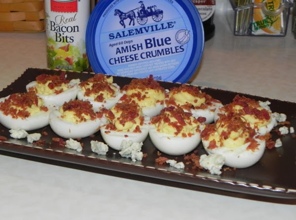 Fill the whites evenly with the mixture and garnish each egg half with the...