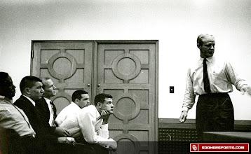 Photo: Wilkinson leading a team meeting.